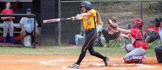 Softball player swinging at a pitch during a game at PHSC.
